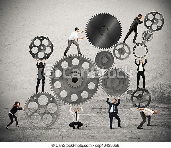 Trabajo en equipo de gente de negocios - csp40435656