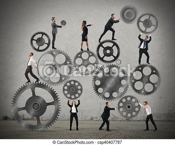 Trabajo en equipo de gente de negocios - csp40407787