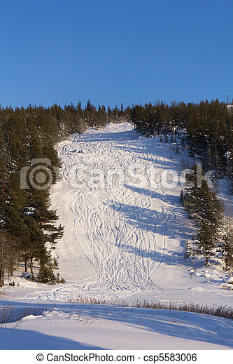 Traces of skiing on the mountain - csp5583006