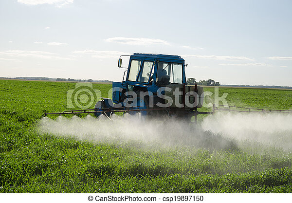 Tractor fertilize field pesticide and insecticide  - csp19897150