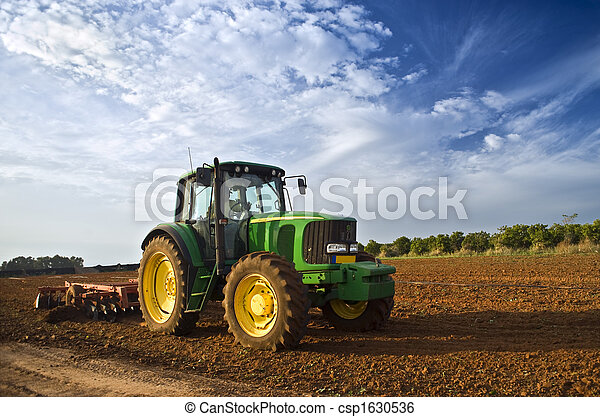 tractor in a field - csp1630536