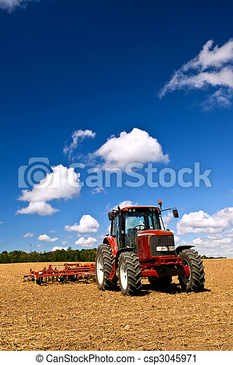 Tractor in plowed field - csp3045971