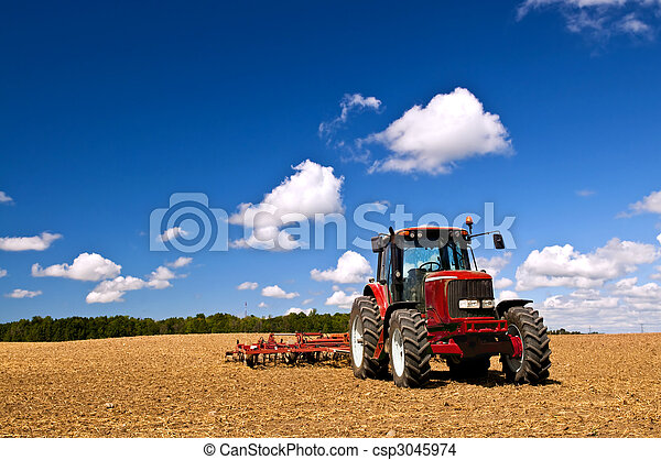 Tractor in plowed field - csp3045974