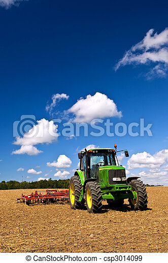 Tractor in plowed field - csp3014099