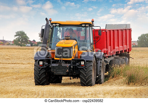 Tractor on wheat field - csp22439582
