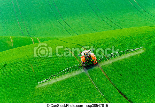 Tractor spraying the chemicals - csp38547815