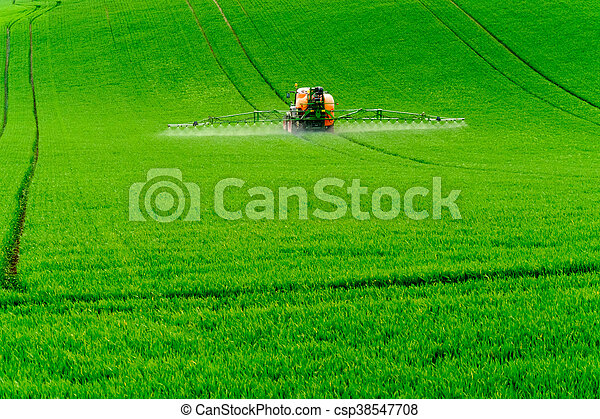 Tractor spraying the chemicals - csp38547708