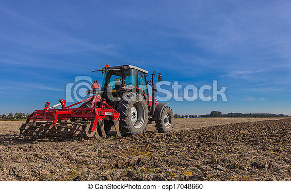 Tractor with Plough at Work - csp17048660