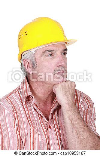 Tradesman deep in thought - csp10953167