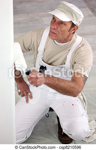Tradesman painting a wall - csp8210596