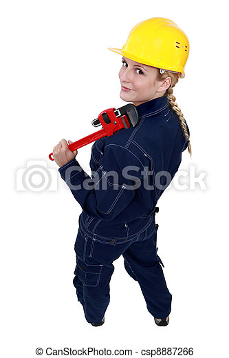 Tradeswoman holding a pipe wrench - csp8887266
