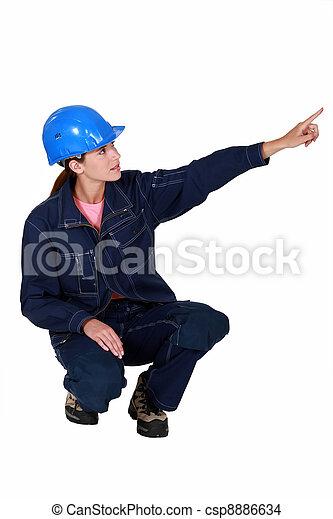 Tradeswoman pointing sideways - csp8886634