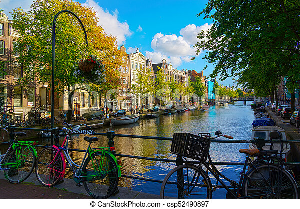 Traditional dutch bicycle parked on canal in Amsterdam - csp52490897
