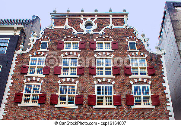 Traditional dutch building in Amsterdam - csp16164007