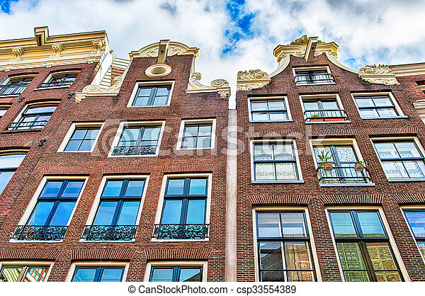 Traditional dutch buildings, Amsterdam - csp33554389