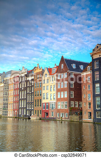 Traditional dutch buildings . canal in Amsterdam - csp32849071