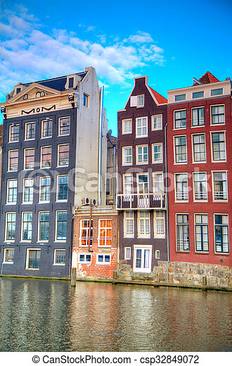 Traditional dutch buildings . canal in Amsterdam - csp32849072