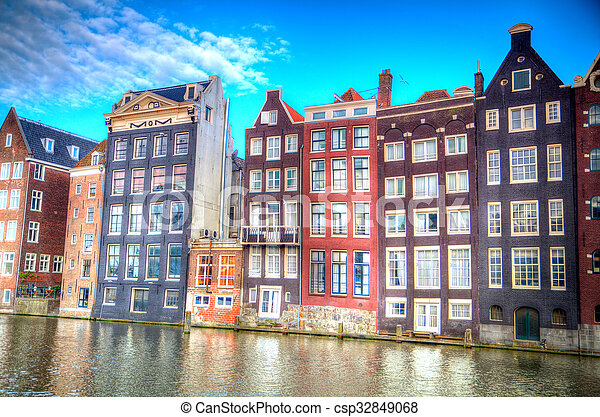 Traditional dutch buildings . canal in Amsterdam - csp32849068