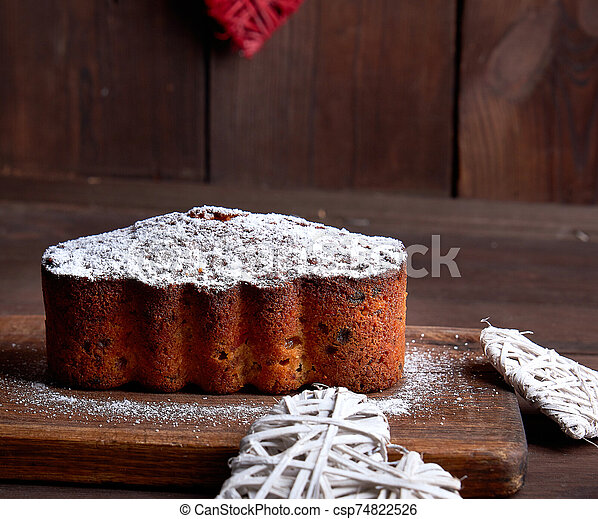 traditional European Stollen cake with nuts and candied fruit - csp74822526