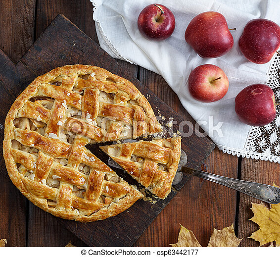traditional fruit cake on a brown wooden board - csp63442177