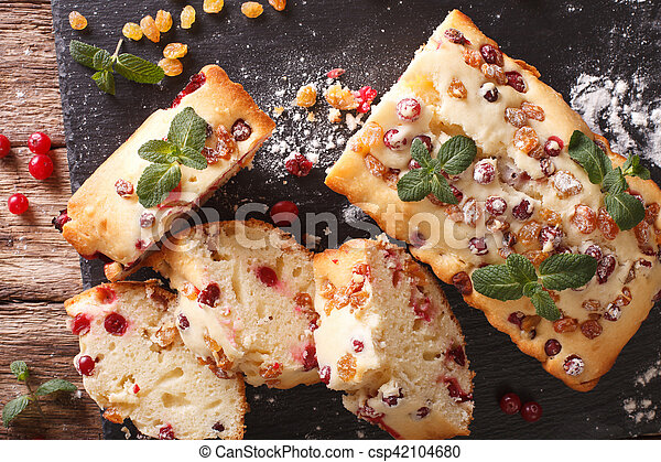 Traditional fruit cake with cranberries and raisins close-up. horizontal top view - csp42104680
