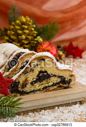 traditional german christmas cake and decoration csp32786913