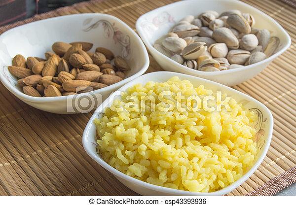 Traditional Indian Pongal, Makar Sankranti rice, nuts, almonds, selective focus - csp43393936