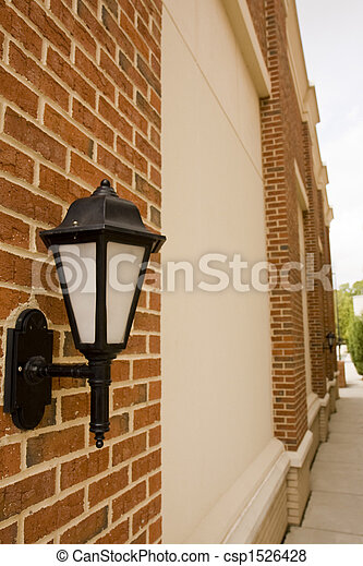 Traditional Iron Lamp on Brick Columned Wall - csp1526428
