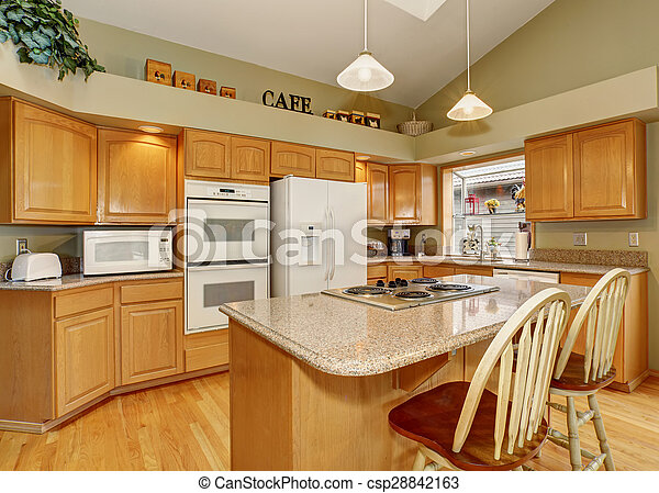 Traditional kitchen with dinning area. - csp28842163