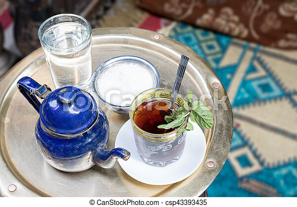 Traditional mint tea set on copper table, Cairo, Egypt - csp43393435