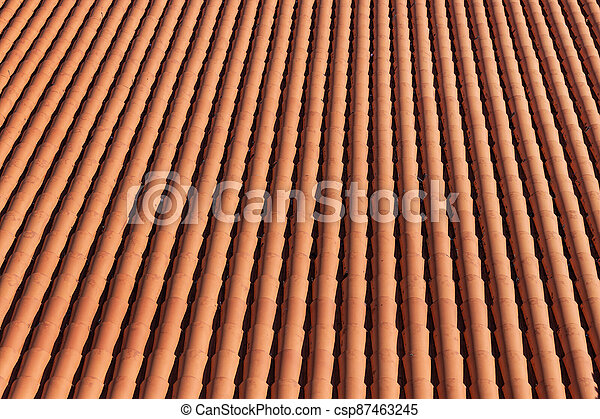 Traditional red clay roof tiles background. Top view - csp87463245