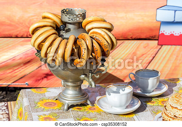 Traditional Russian Tea From Samovar With Bagels And Pancakes Canstock