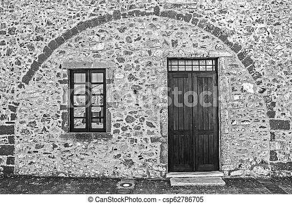 traditional stone wall, door and window at the castle of Monemvasia Greece Laconia Peloponnese Greece - csp62786705