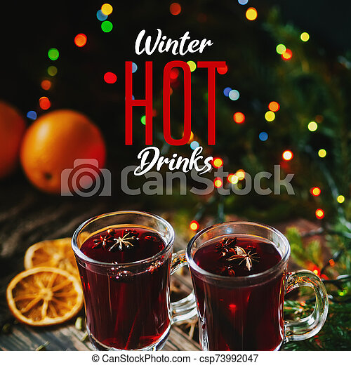 traditional winter hot drink mulled wine in glasses on the background of Christmas decor - csp73992047