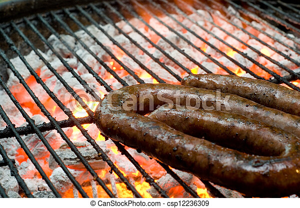 Tradtional South African braai barbecue borewors sausage on fire - csp12236309