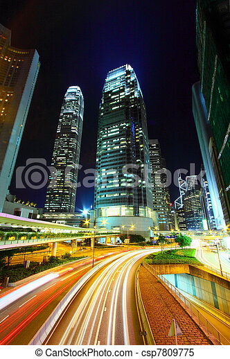Traffic in city at night, it shows the busy business environment of Hong Kong. - csp7809775