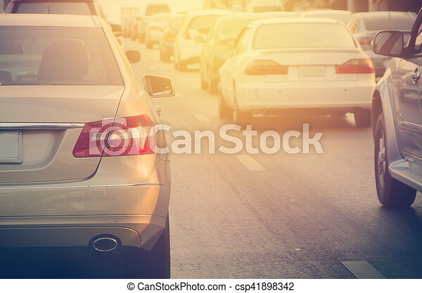 traffic jam with rows of cars during rush hour on road - csp41898342