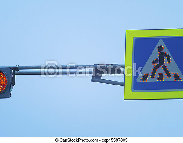Traffic light and sign of pedestrian crossing - csp45587805