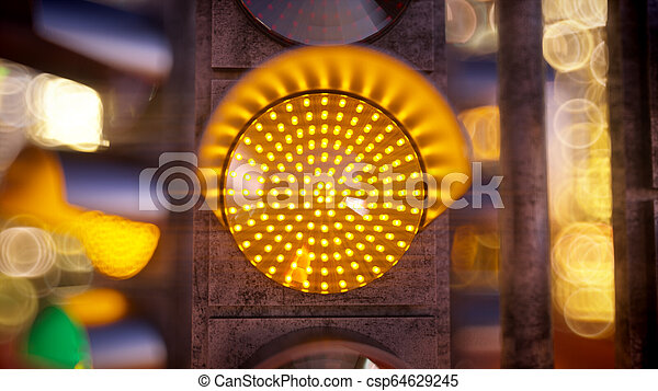 Traffic light in modern city - csp64629245