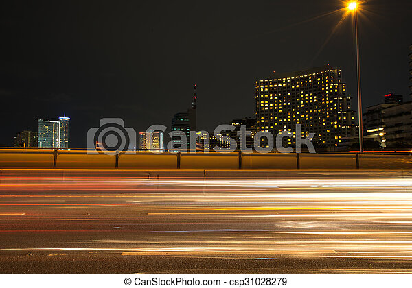traffic light trails in modern city at night - csp31028279