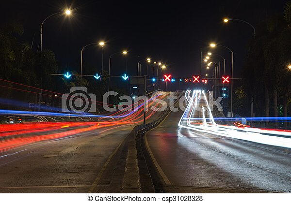 traffic light trails in modern city at night - csp31028328