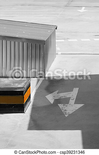 Traffic sign on an empty parking lot with shadow - csp39231346