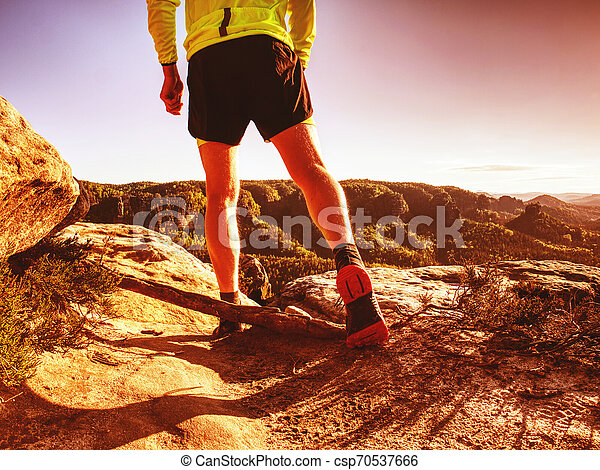 Trail runner athlete man. Slim person training in mountains - csp70537666