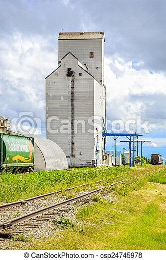 Train at Grain Elevator - csp24745978