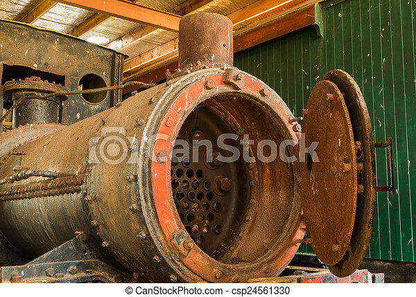Train boiler. Looking inside and old steam engine train boiler.