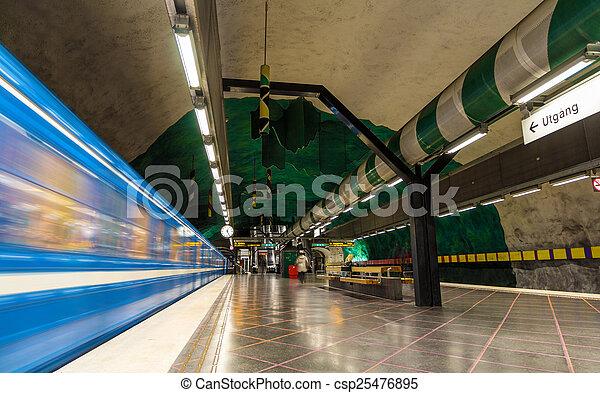 Train leaving Huvudsta metro station in Stockholm - csp25476895