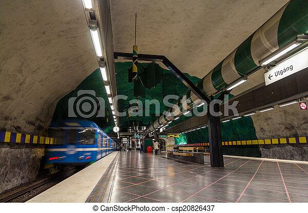 Train leaving Huvudsta metro station in Stockholm - csp20826437
