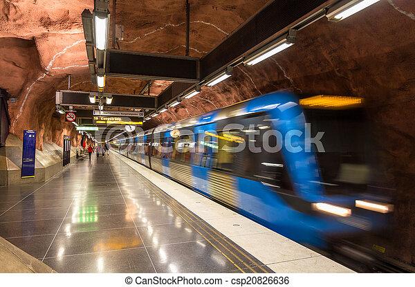 Train leaving Radhuset metro station in Stockholm - csp20826636