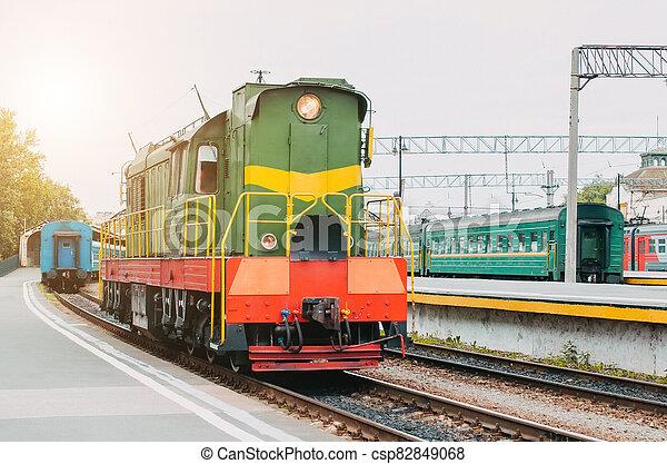 Train, shunting locomotive on the passenger platform. - csp82849068