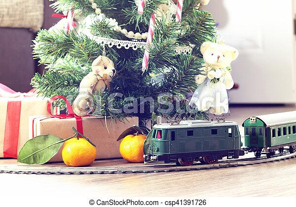train under tree gift - csp41391726